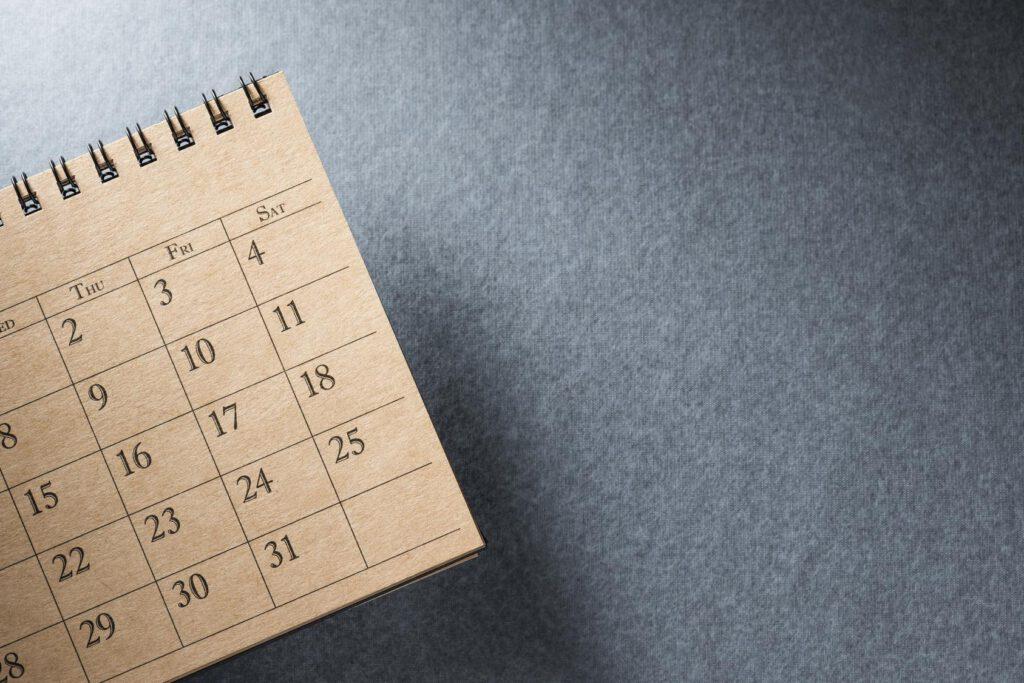 desk calendar on blank desk