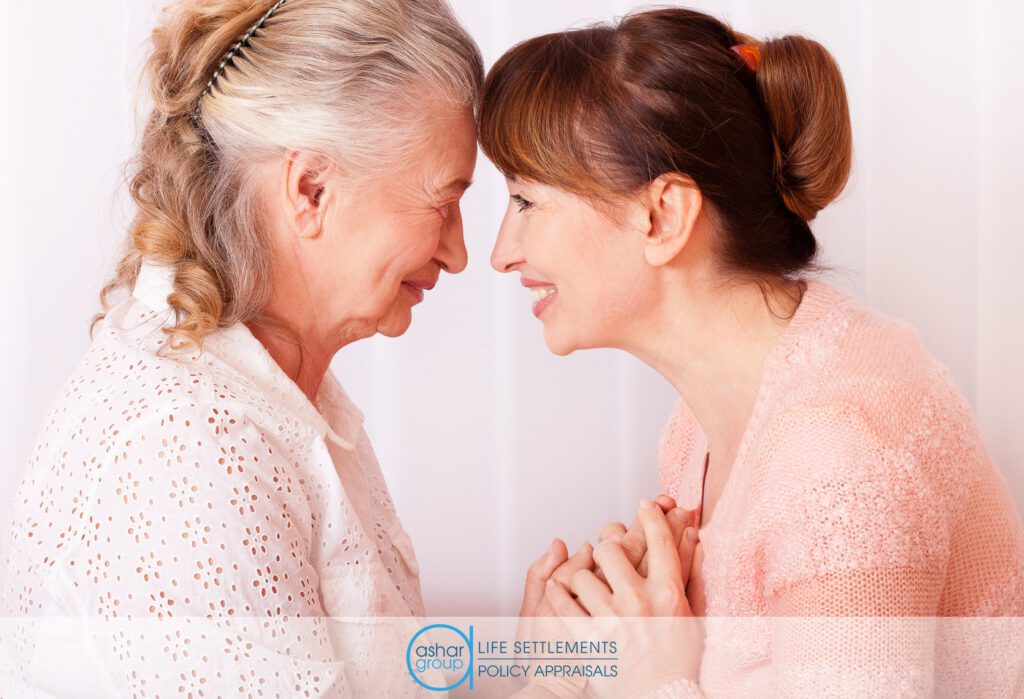 Senior woman with loving caregiver holding hands and smiling