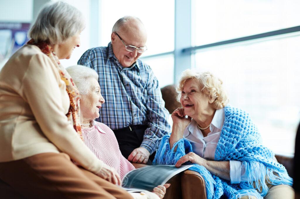 group of happy seniors talking
