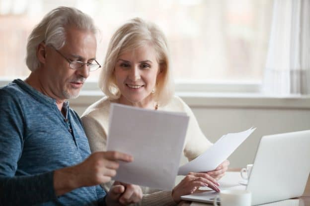senior couple reviewing life insurance policy